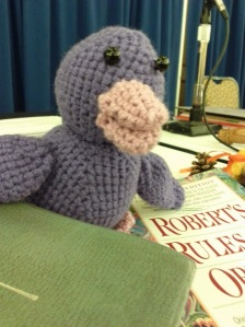 Here he is, Scaife the Duck, at Convention 176, on the head table between Roberts Rules of Order and the Constitution & Canons of the Episcopal Church